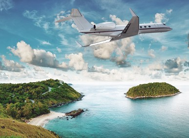 Private jet landing on tropical island