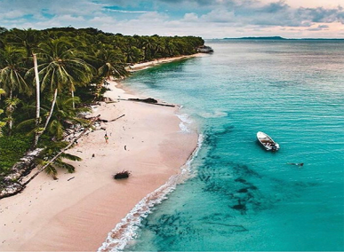 Aerial beach and boat with crystal waters