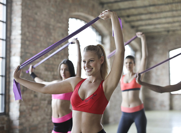 Women exercising with therabands