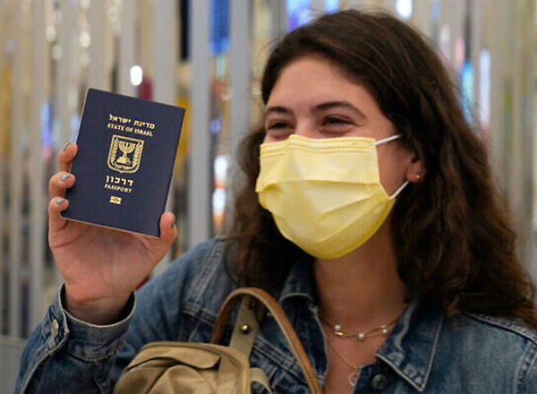 woman with mask and israli passport