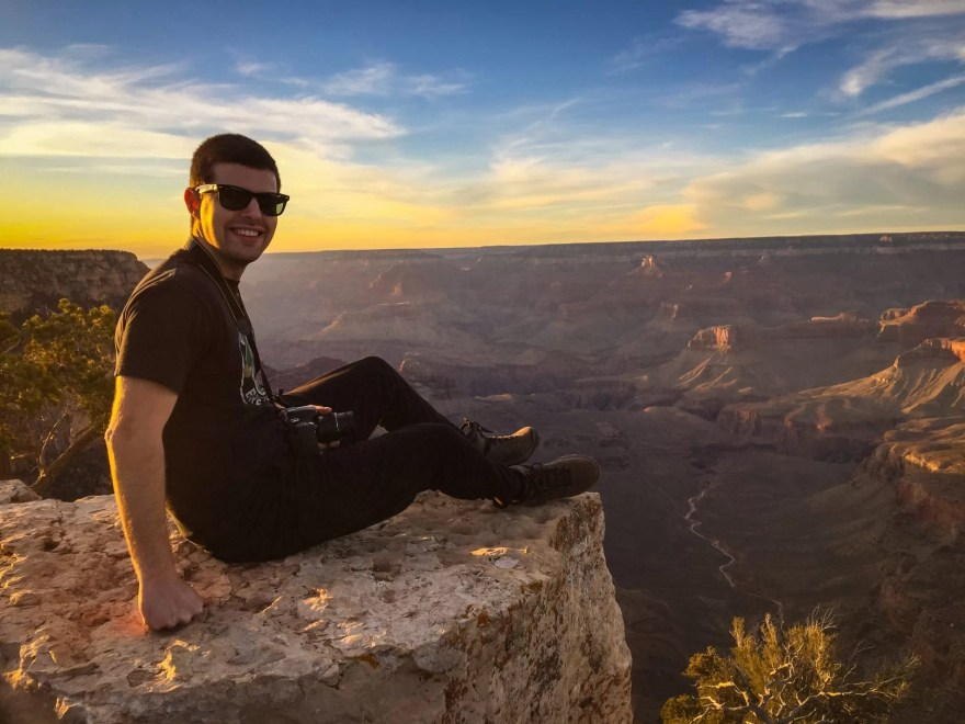Sitting at Shoshone Point on the edge of the South Rim of the Grand Canyon.