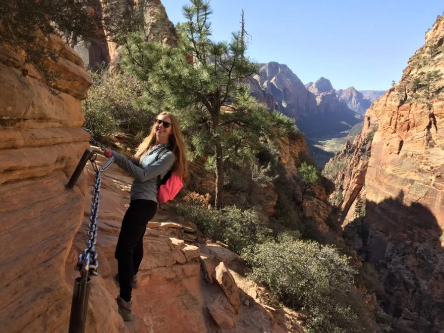 Erin hanging on the edge of Angel's Landing in Zion National Park.