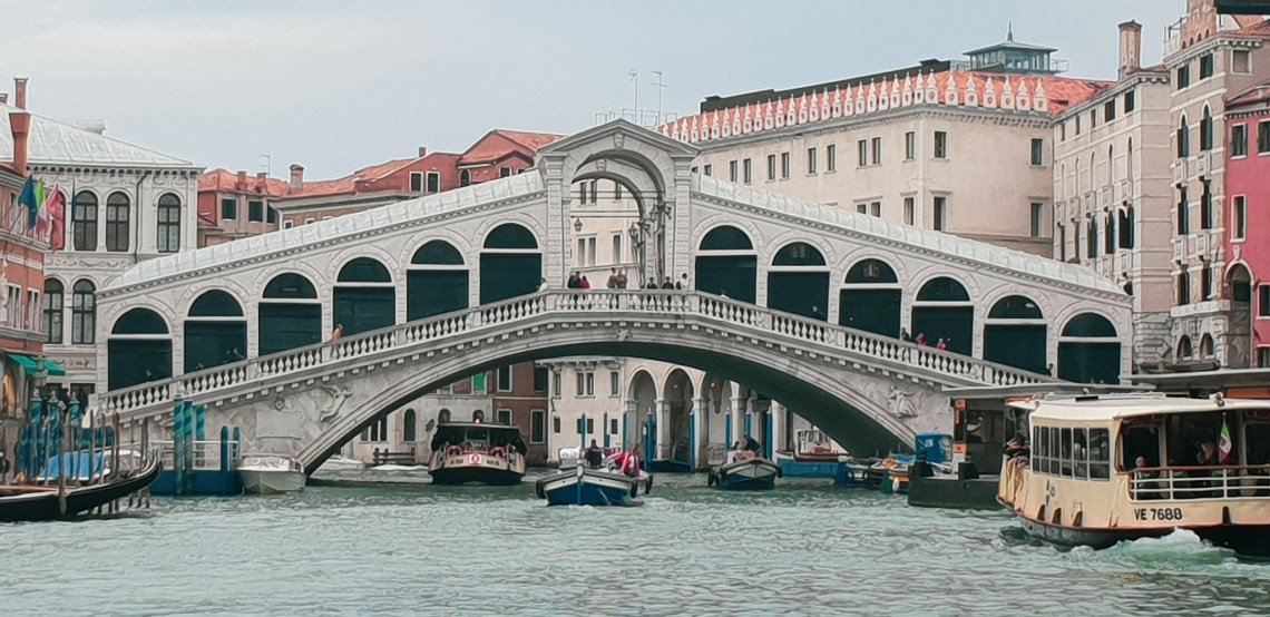 The Rialto Bridge reaching across teh Grand Canal, Venice, Italy