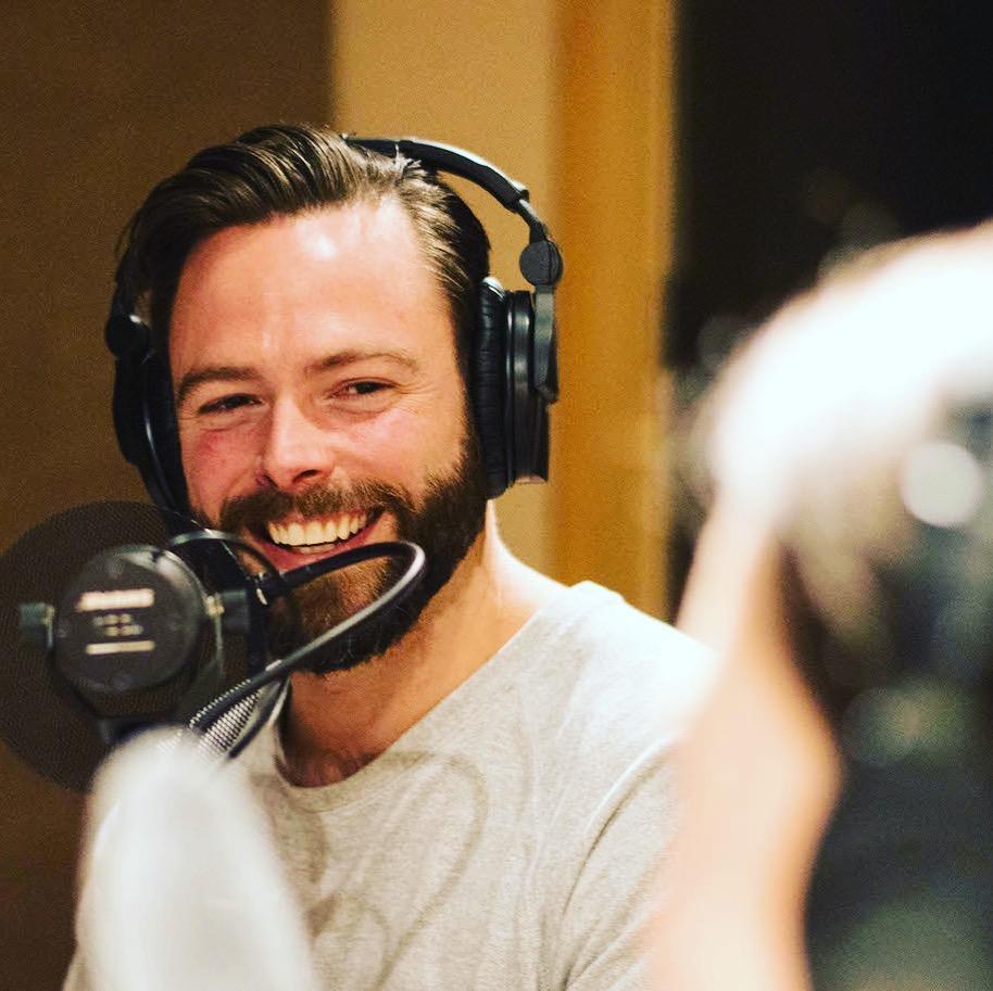 Robert Sharp recording The Gay Travel Podcast