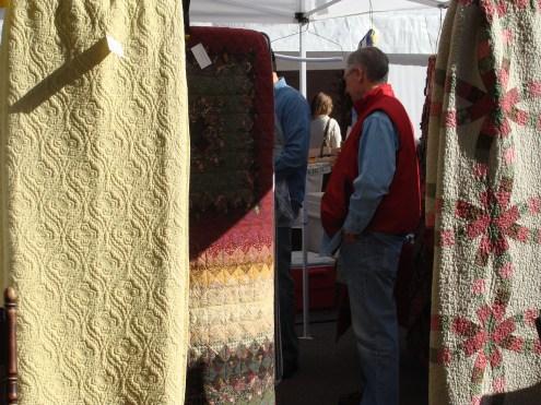 Quilt vendor shopper old fashioned apple butter kettle fire