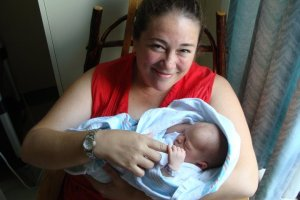 "Holding my first grand-niece, Adeline, in 2011. This is my ""in love"" look. <3"