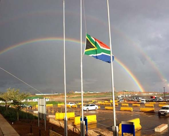 A double rainbow with the South African flag at half mast after Mandela died. This photo is from the site where my husband works. Courtesy of Kevin Perry.