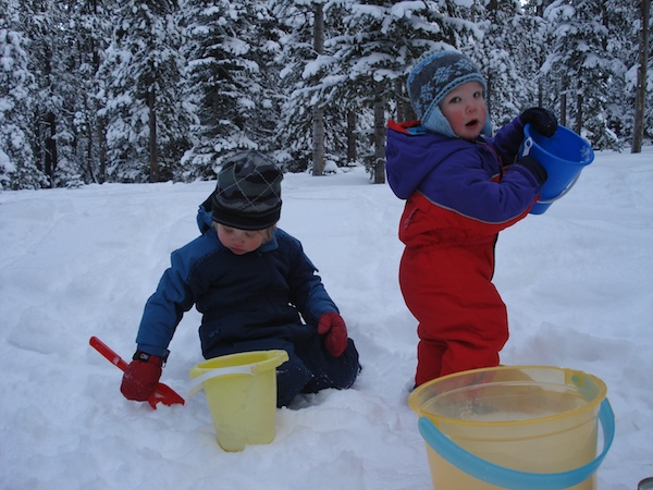 Playing in the snow outside a Forest Service cabin.