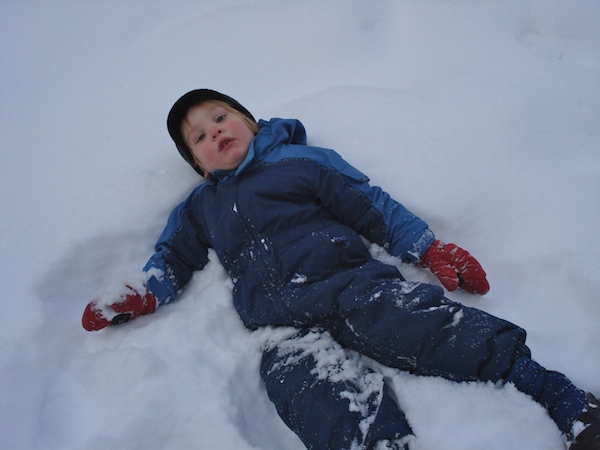 Falling in the snow in a Columbia snowsuit in the Castle Mountains.