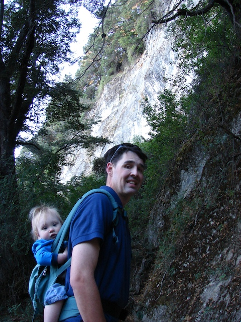 Henry hikes along a steep cliff face