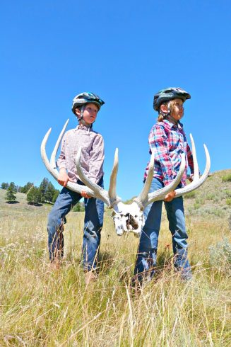 Horseback riding in Yellowstone National Park with Wilderness Pack Trips boys holding elk horns
