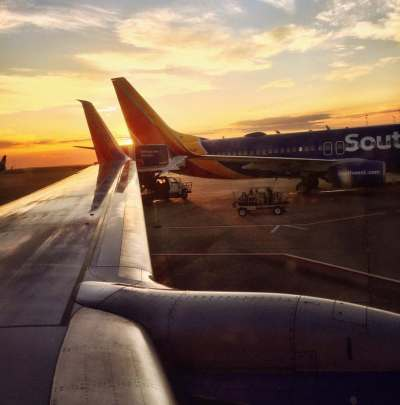 Planes parked at the gate at sunrise