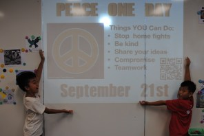 These boys designed this poster that we put up all around the school to help students be nonviolent and celebrate Peace One Day