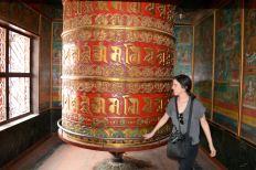 Alie Spinning a Buddhist Prayer Wheel