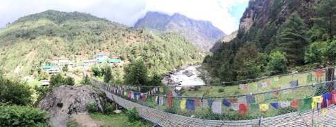 Village and Bridge Amidst Mountain Backdrop (Day 2 to Namche Bazaar)