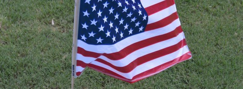 American Flag home of the slave to debt
