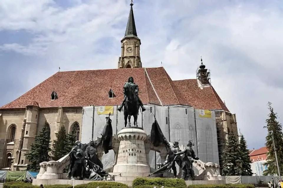 St. Michael's Church behind the Matthias Corvinus statue in Piata Unirii, Cluj-Napoca, Romania