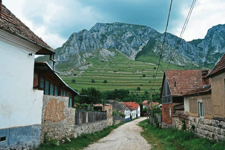 Szelek village in Transylvania with mountain backdrop.