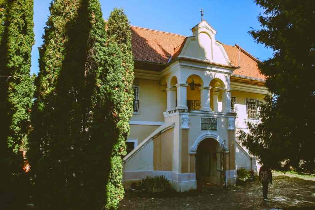 Pale-hued façade of the First Romanian School Museum in Brasov, Transylvania, Romania.