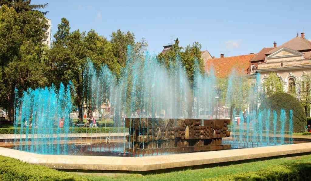 Famous fountain of Satu Mare with blue water in Romania.