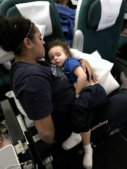 baby sleeping on mother on trans atlantic flight-jet lag in babies