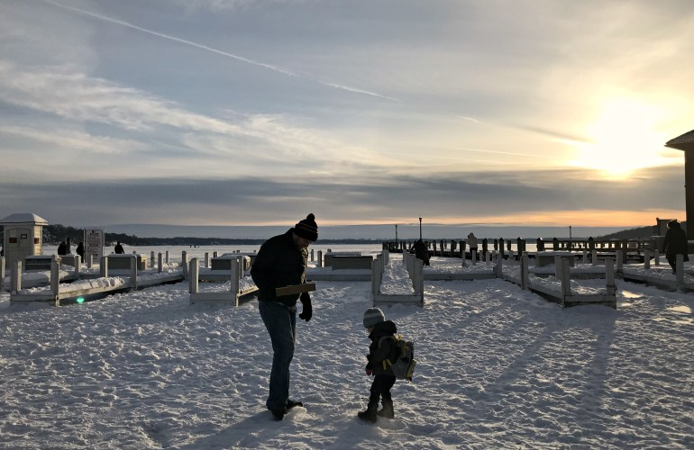 Toddler playing on frozen Lake Geneva, Things to do In Lake Geneva with Kids