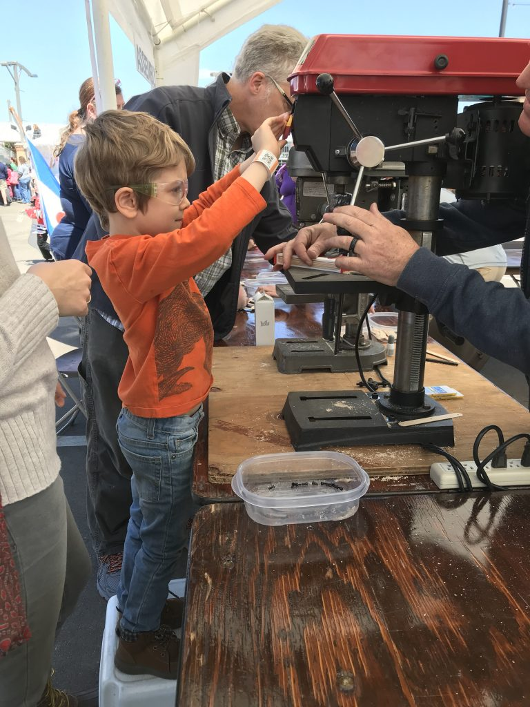 Tulip Time for Families, building with power tools at Kinderplaats