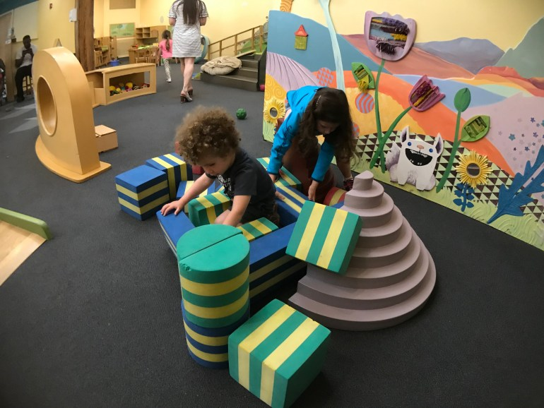 Children playing on blocks at the Wee Discovery Exhibit at the Grand Rapids Children's Museum