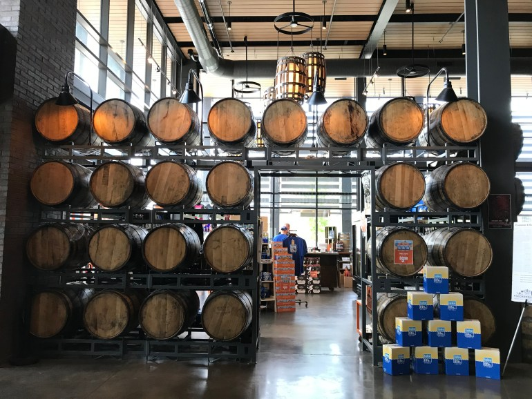 Beer barrels stacked up in entryway into New Holland Brewing in Grand Rapids