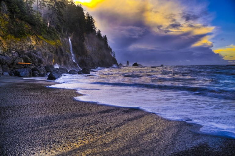 Crashing waves and colorful sunset at La Push Beach in Olympic National Park