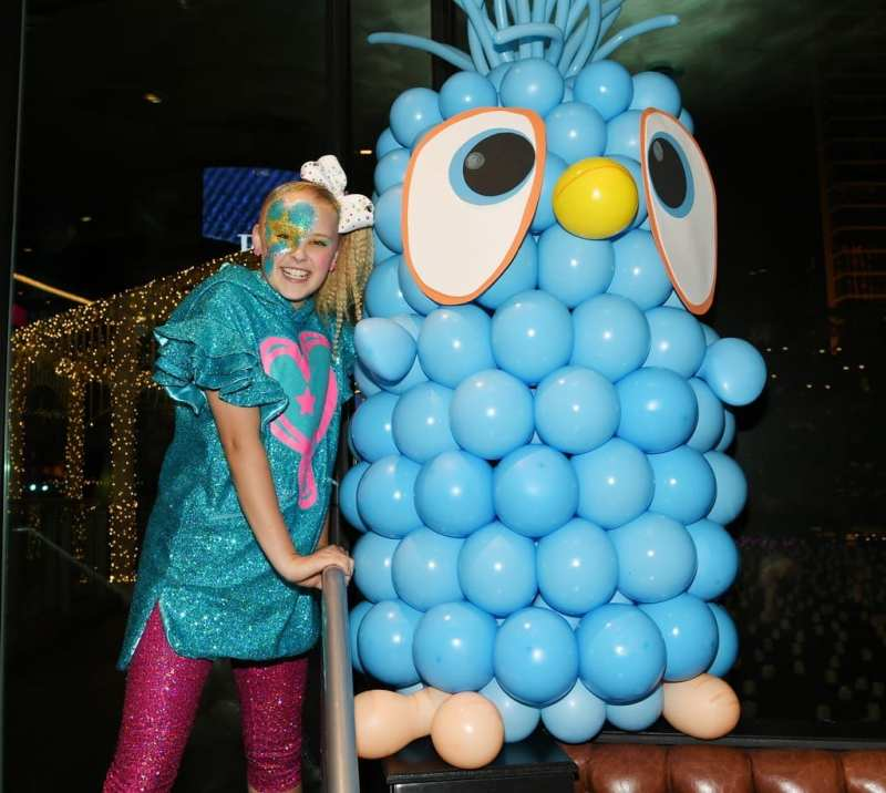 JoJo Siwa poses with life-size Angry Birds The Movie 2 character Jay.