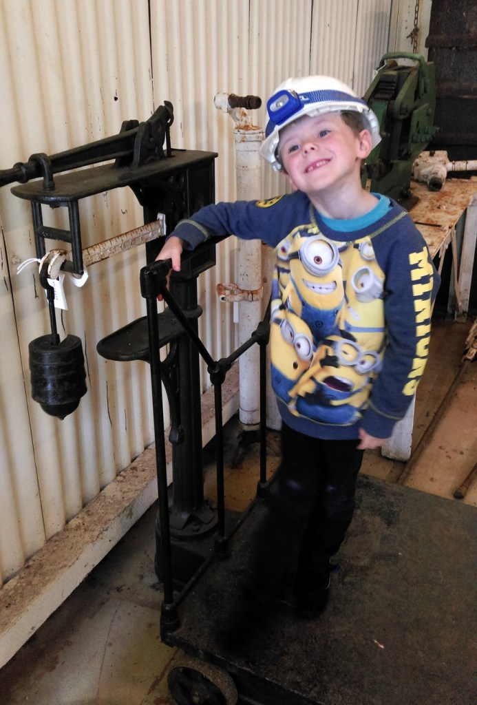 All kitted up to go down the mine at Dolaucothi; from a travelblog by www.traveljunkiegirl.com