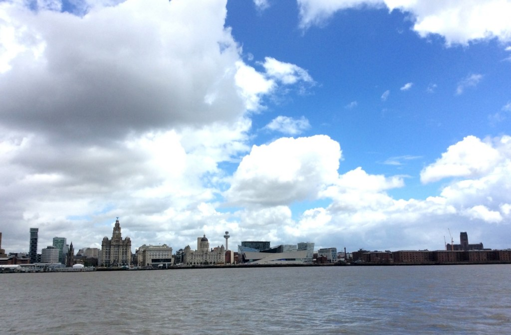 Looking across the River Mersey from Seacombe, Wirral, to the Liverpool Waterfront; from a travel blog by www.traveljunkiegirl.com
