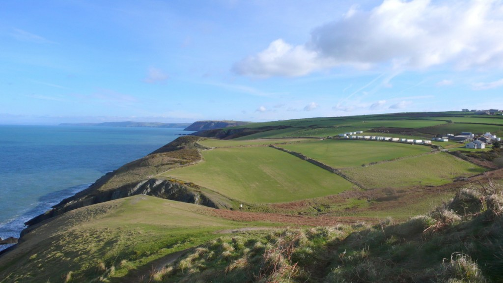Looking north east along the coast from Mwnt, Ceredigion; from a travel blog by traveljunkiegirl.com