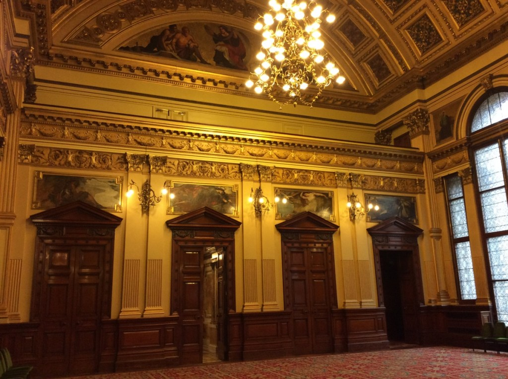 The murals above the doors in the Banqueting Hall depict Scottish rivers, City Chambers Building in Glasgow; from a travel blog by www.traveljunkiegirl.com