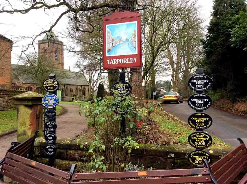 The Village of Tarporley in Cheshire has won many awards and displays them proudly at the entrance to St Helen's Church; from a travel blog by www.traveljunkiegirl.com
