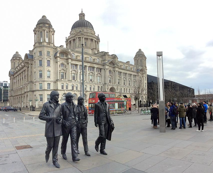 The 'Fab Four' in front of the Port of Liverpool Building, one of the Three Graces on Liverpool's UNESCO Waterfront. Discovered on the Sandemans New Liverpool Walking Tour; from a travel blog by www.traveljunkiegirl.com