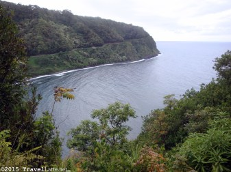 The Road to Hana can take hours to drive because there are so many beautiful scenes, like this of the isolated Maliko Bay, with The Road winding along the far side.