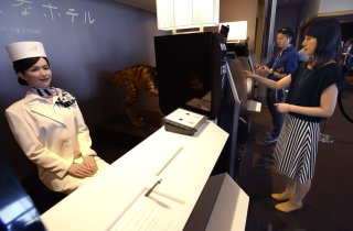 Photo: Feminine robotic desk clerk at Henn na Hotel, Japan
