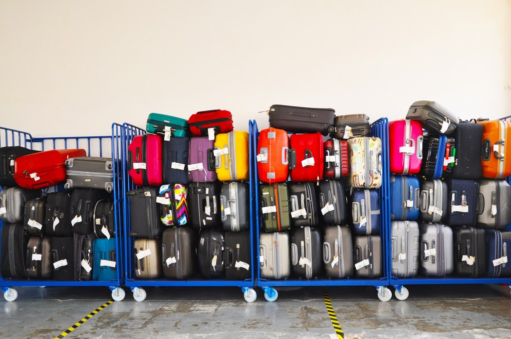 Checked bags on luggage carts - Carry-on vs Checked Luggage via @TravelLatte.net