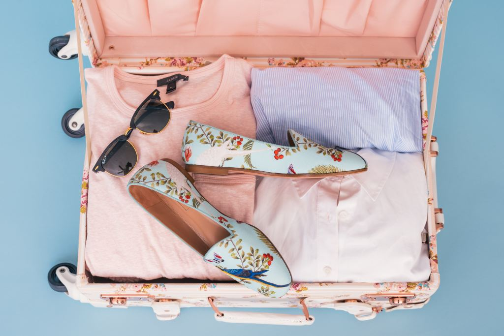 Packed Suitcase - Three Packing Strategies - TravelLatte