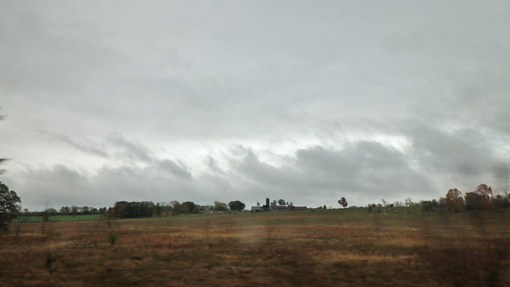 A farm in Upstate New York, seen from the Amtrak Adirondack, by TravelLatte.