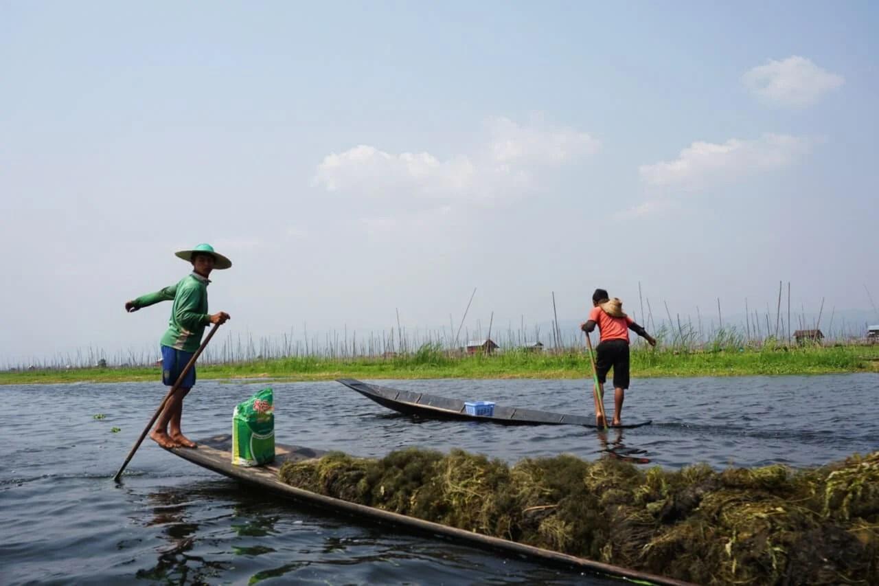 Myanmar photos fishermen passing Lake Inle Burma