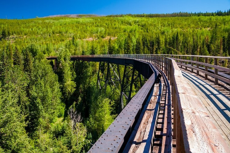 A railroad track sits high above the trees in the Okanagan Valley, British Columbia