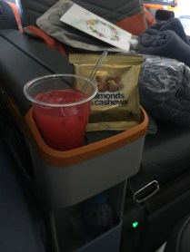 Singapore sling and nuts after take-off