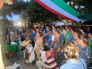 Italian fans standing for the national anthem at the start of the Euro 2012 final, Monterosso, Italia