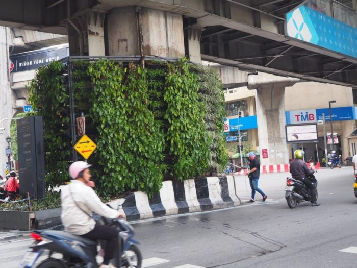 Notice the guy watering the vertical garden around a pillar that supports the train line above and has three lanes of traffic either side of if