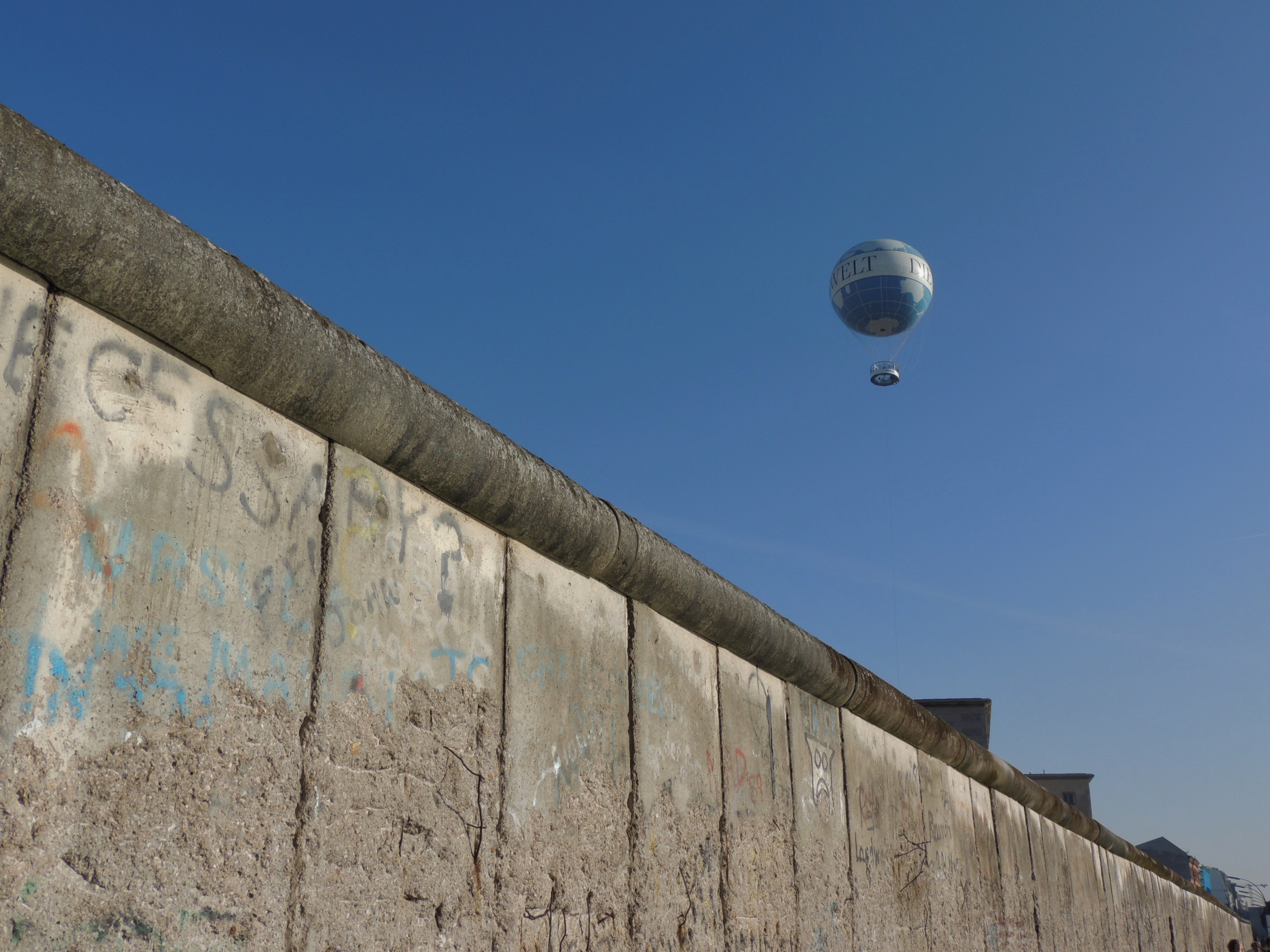 the crumbling berlin wall by day photo essay the travelling i spotted the air balloon promoting the newspaper die welt which created a nice bit of contrast between the wall and the world