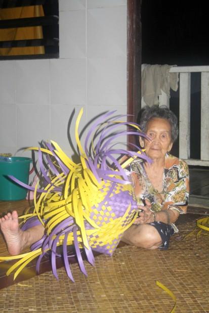 Local woman in an Iban Longhouse in Sarawak, Malaysian Borneo