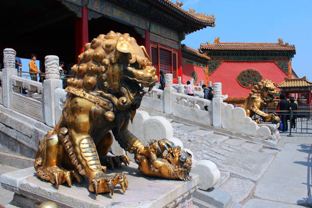 Lion statues guard the Gate of Supreme Harmony